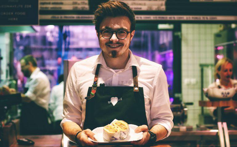 friendly waiter serving food