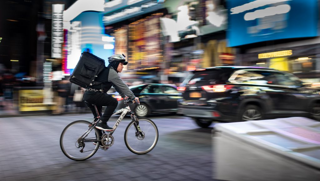 delivery man riding a bike