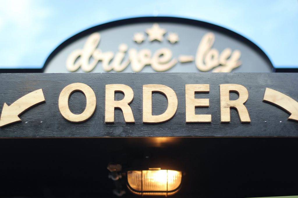 "sign saying ""drive-by order"""
