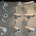 lots of security cameras on a wall
